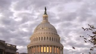 The sun set over the U.S. Capitol as Americans cast final votes nationwide in congressional midterm elections at the end of a divisive campaign