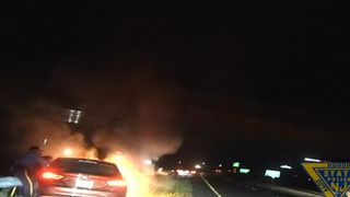Man rescued from burning car.