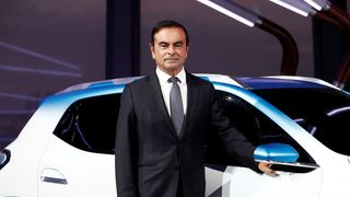 Carlos Ghosn, Chairman and CEO of the Renault-Nissan Alliance, poses with an electric show car called Renault K-ZE prior the opening of the Paris auto show in Paris, France October 1, 2018