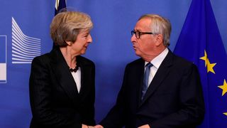 EU Commission President Jean-Claude Juncker (R) welcomes British Prime Minister Theresa May for a meeting at the EU Headquarters in Brussels on November 21, 2018. - The British Prime Minister on November 21 briefly escaped the Westminster bear pit to bring her Brexit battle to Brussels, just four days before the divorce deal is to be signed. (Photo by JOHN THYS / AFP) (Photo credit should read JOHN THYS/AFP/Getty Images)
