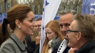 The Duchess of Cambridge sympathises with staff and fans at Leicester City after laying flowers at the site where the club's owner's helicopter crashed
