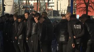 Leicester City players view floral tributes outside King Power Stadium