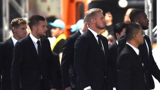 Wes Morgan (R) Kasper Schmeichel and Jamie Vardy were among those who visited
