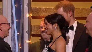 Meghan cradles baby bump at Royal Variety Performance