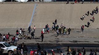 Migrants rush the US border in Mexico