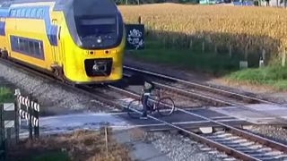 ProRail release footage of a cyclist riding across the path of an oncoming train on an 'unguarded' level crossing