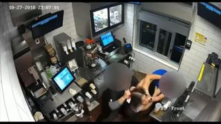 CCTV shows another employee trying to pull her away from the manager