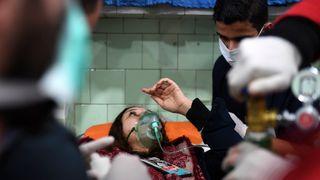 A Syrian woman receives treatment