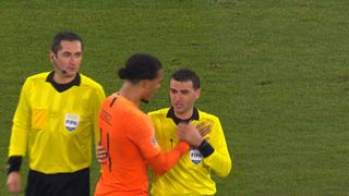 Romanian referee Ovidiu Hategan was consoled by Virgil van Dijk after the Netherlands' 2-2 draw with Germany on Monday.