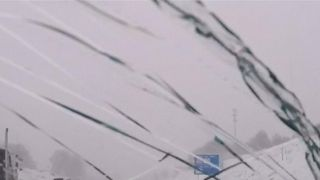 Driver's windscreen is cracked by snow ploughed over bridge in Michigan