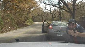 Driver fires shots at police car.