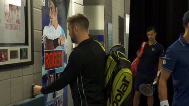 Sock tries to break into Federer's changing room!