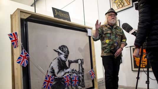 US artist Ron English bought Banksy's protest artwork Slave Labour for 730,000 US dollars