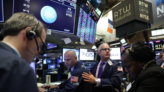 Traders work on the floor at the New York Stock Exchange (NYSE) in New York, U.S., November 20, 2018.