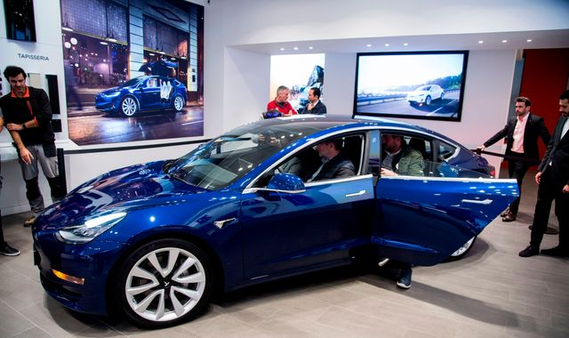 Tesla to cut 7% of workforce after 'most challenging' year