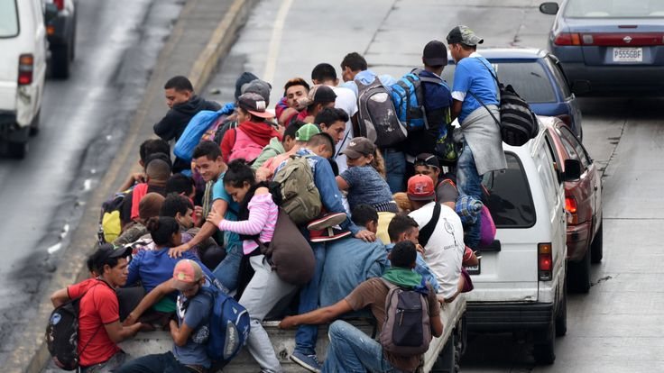 Honduran migrants aboard vehicles head in a caravan to the United States, in Guatemala City, on October 18, 2018