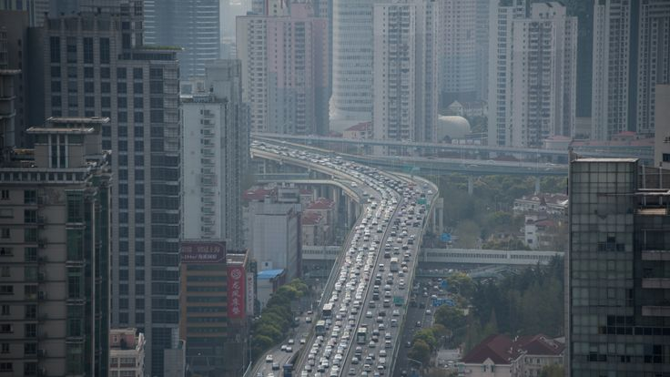 This picture taken on April 1, 2015 shows cars on an elevated road in Shanghai