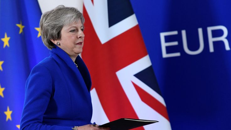 Theresa May arrives at a news conference after an extraordinary EU leaders summit to finalise and formalise the Brexit agreement in Brussels
