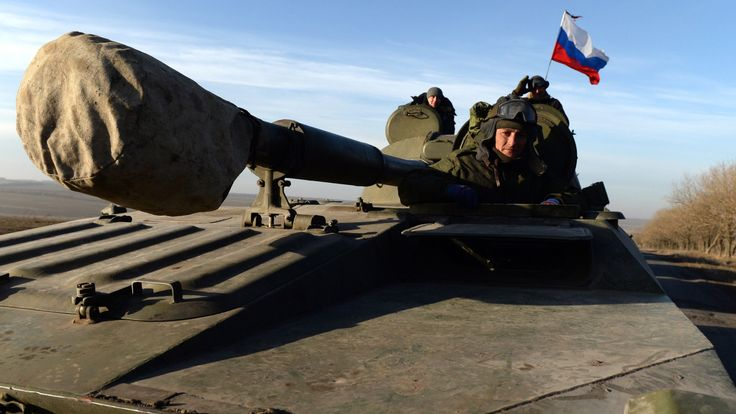 A Russian flag flies on a tank as pro-Russian forces move from the frontline near Starobeshevo, Donetsk region, in 2015