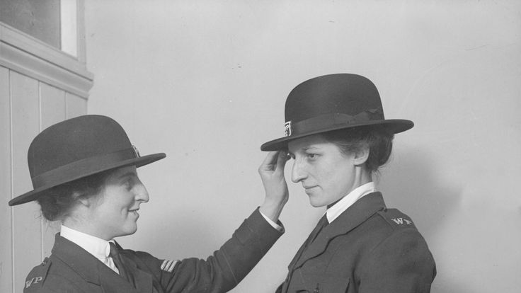 Two female police officers prepare for duty at a munitions factory in 1917