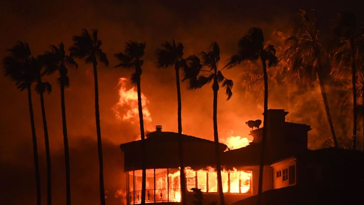 A house burns during the Woolsey Fire in southern California