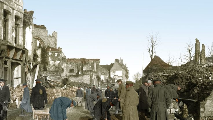 German prisoners of war, under British guard, mending the road and clearing rubble in the northern French town of Bethune, near the former Western Front