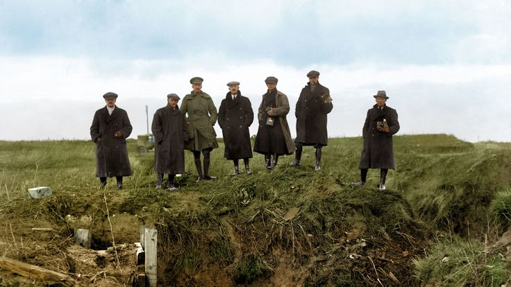 Journalists and photographers from various news agencies at a machine gun post in an abandoned German trench, part of the series of fortifications on the Western Front known as the Hindenburg Line