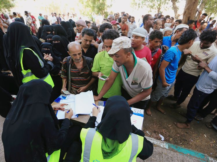 Yemenis gather at a UN aid distribution centre in Hodeidah