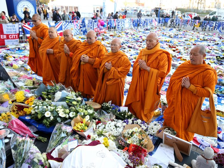 Buddhist monks pay their respects at Leicester City football club