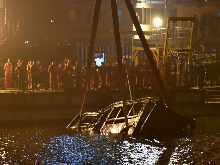 Bus plunges into Chinese river after fight between driver and passenger