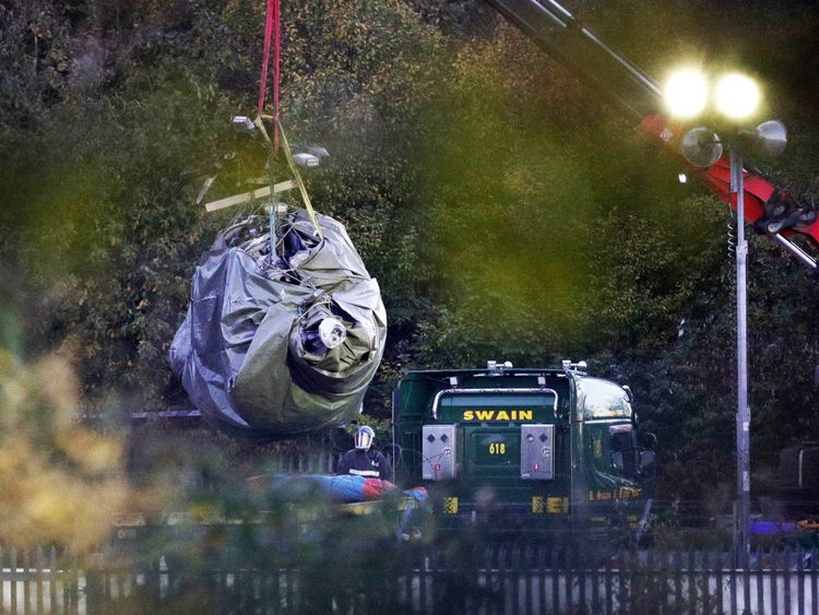 Crane moves helicopter wreckage