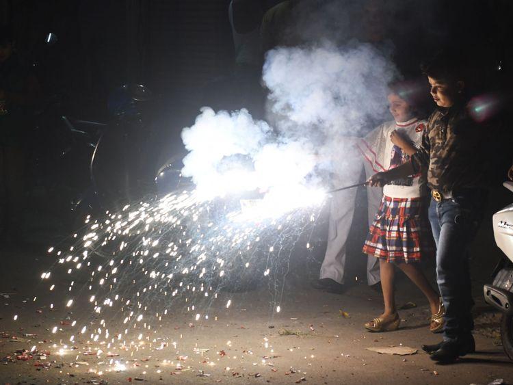 Indian children light firecrackers