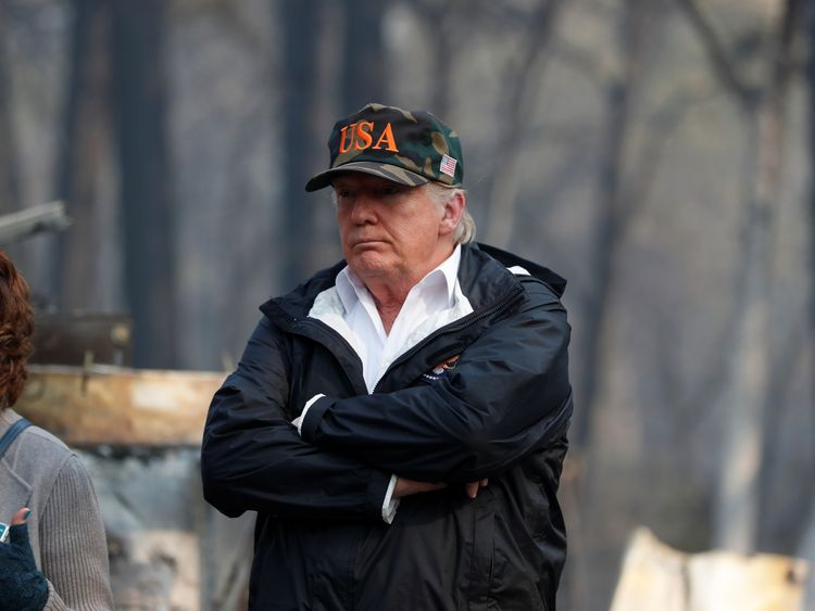U.S. President Donald Trump visits the charred wreckage of Skyway Villa Mobile Home and RV Park in Paradise, California, U.S., November 17, 2018. REUTERS/Leah Millis