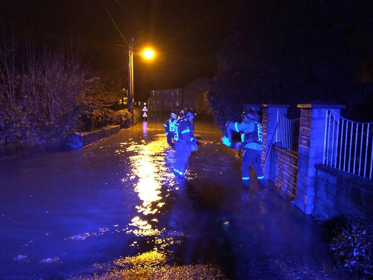Police and firefighters attend a pub and a house after flooding in Milford Haven. Pic: Dyfed Powys police