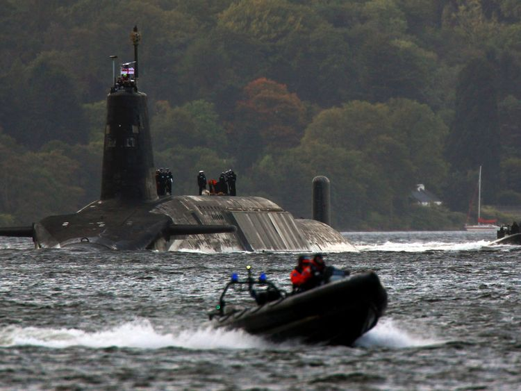 FASLANE, SCOTLAND - SEPTEMBER 23: A trident submarine makes it's way out from Faslane Naval base on September 23, 2009 in Faslane, Scotland. British prime minister Gordon Brown, will tell the UN the he will cut the trident missile carrying submarine from four to three. (Photo by Jeff J Mitchell/Getty Images)