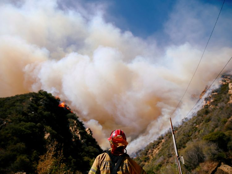 Firefighters battle the Woolsey Fire as it continues to burn in Malibu