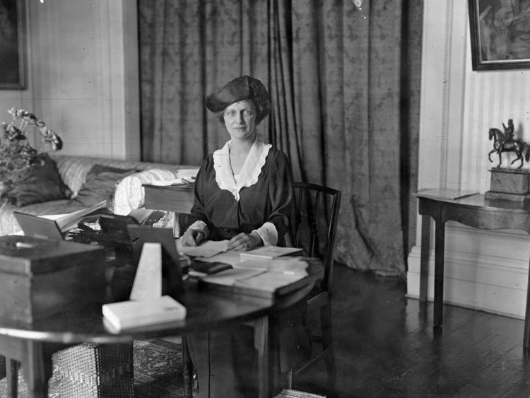 American-born British politician Nancy Witcher Langhorne, Viscountess Astor (1879 - 1964), Conservative candidate at the Plymouth election sitting at a worktable. She won the election and became the first woman member of parliament. (Photo by G. Adams/Topical Press Agency/Getty Images)