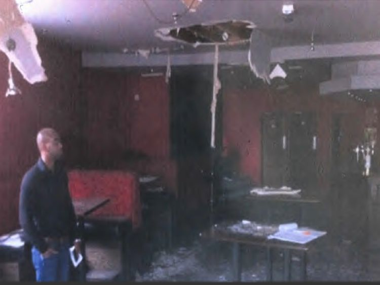 Hughes stands in one of properties the gang claimed for. Pic: City of London police