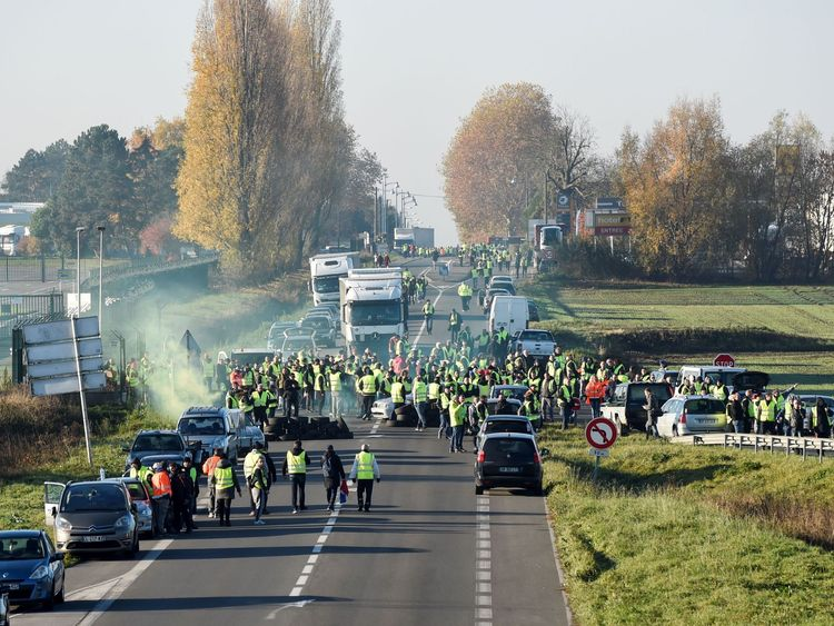 Demonstrators wearing yellow vests block the traffic during a protest against the rising of the fuel and oil prices