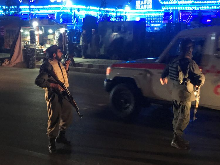 Afghan policeman keep watch at the site of a suicide attack in Kabul