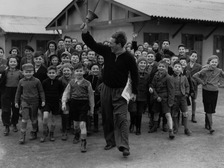 A camp leader in Harwich leads a group of Kindertransport children