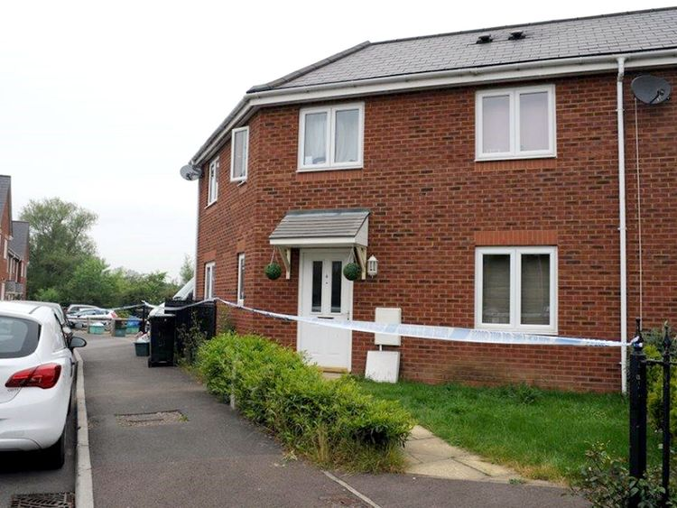 Their home in Gloucester where they were found on the kitchen floor