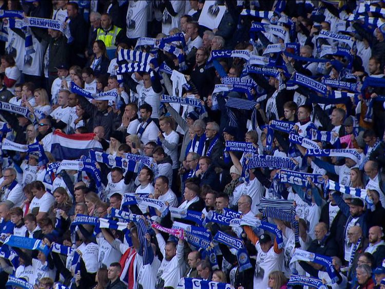 Fans held up their team scarves as a mark of respect