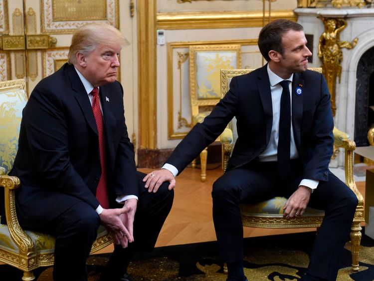 Mr Macron patted Mr Trump's knee at the end of the conference