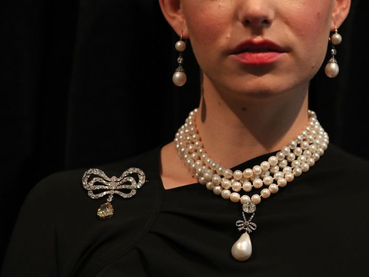 The Marie Antoinette pearl on the pearl and diamond necklace, along with her brooch