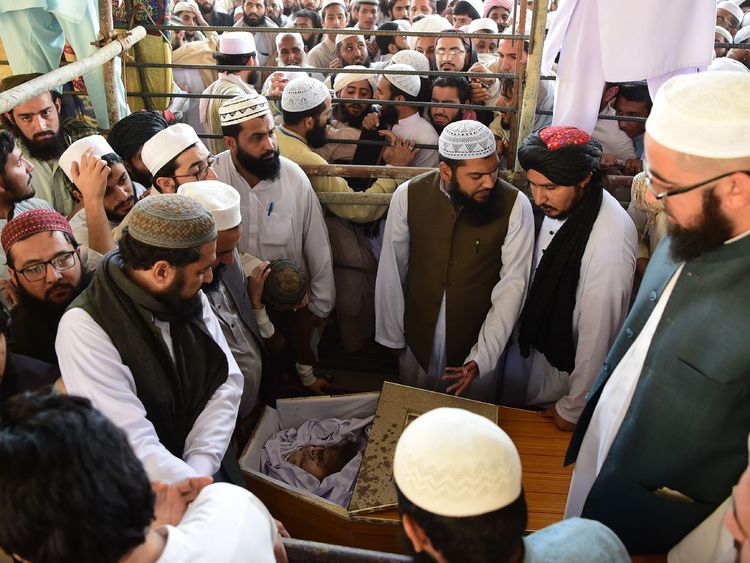 Supporters take a last glimpse of the body of Maulana Sami Ul-Haq during his funeral