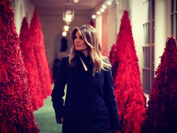 A corridor lined with red trees divided opinion. Pic: Melania Trump/Twitter