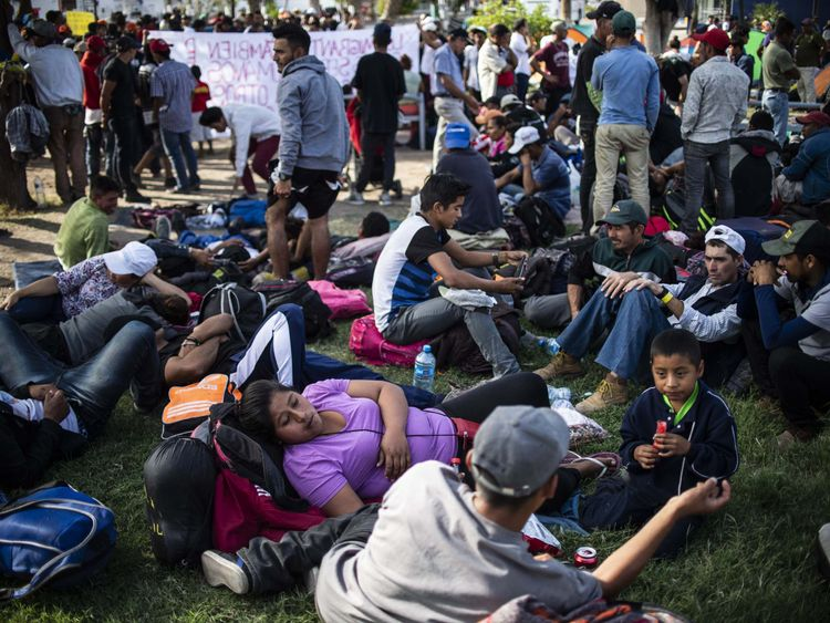 Central American migrants -mostly Hondurans- moving in a caravan towards the United States in hopes of a better life, rest after holding a demonstration in Mexicali's downtown in Mexico's Baja California State, on the border with Calexico, in California, US, on November 19, 2018