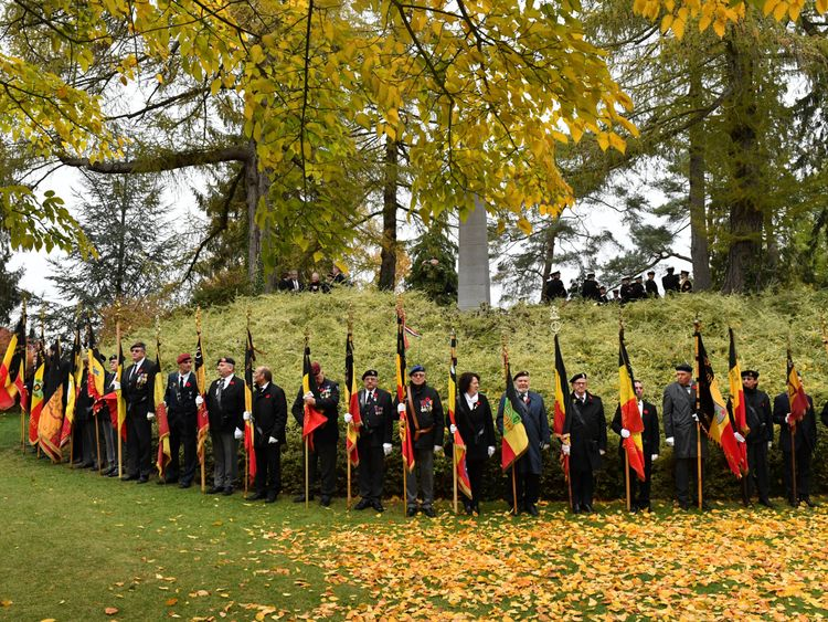 Soldiers attend a Centenary service at the St. Symphorien cemetery in Mons, Belgium