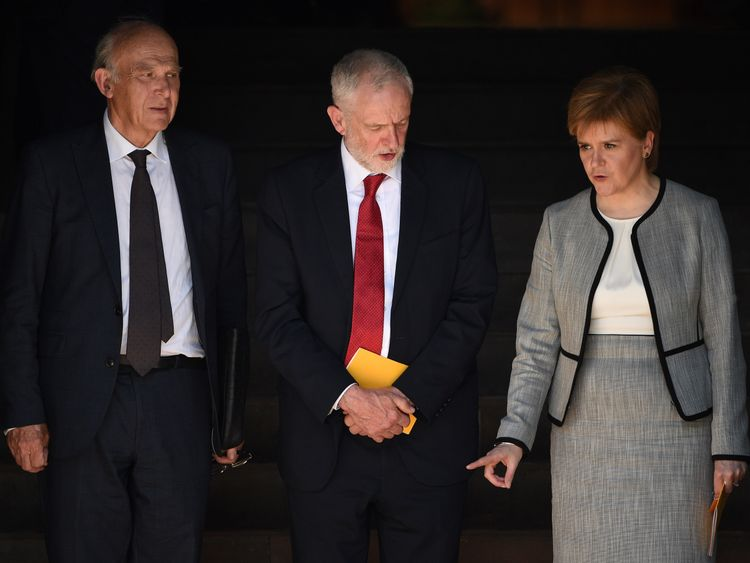 Britain's opposition Labour party Leader, Jeremy Corbyn (C), Scotland First Minister Nicola Sturgeon (R), and Britain's leader of the Liberal Democrats, Vince Cable leave after attending The Manchester Arena National Service of Commemoration at Manchester Cathedral in central Manchester on May 22, 2018, on the one year anniversary of the deadly attack at Manchester Arena.